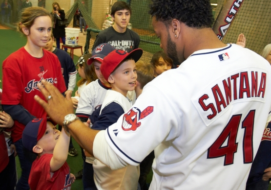Indians catcher Carlos Santana, who will play for the Dominican Republic in the upcoming World Baseball Classic,  interacts with young Indians fans at Tribe Fest on Saturday. (Kyle Emery photo)