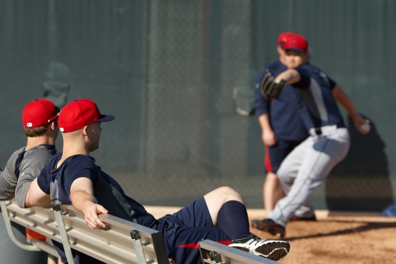 Indians pitchers Cody Allen (left) and Justin Masterson watch fellow hurler Josh Tomlin throw Friday ahead of Sunday's official reporting date for pitchers and catchers. (Dan Mendlik photos)