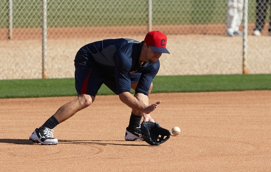 Third baseman Lonnie Chisenhall takes ground balls at the Indians' Spring Training complex in Goodyear, Ariz.