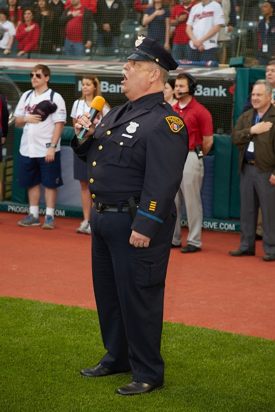 Cleveland Police Officer Jeff Stanczyk presents the national anthem Tuesday night at Progressive Field. (Dan Mendlik photo)