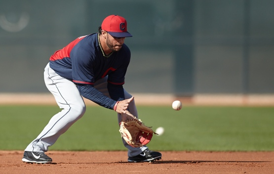 Mike Aviles takes ground balls at second base.
