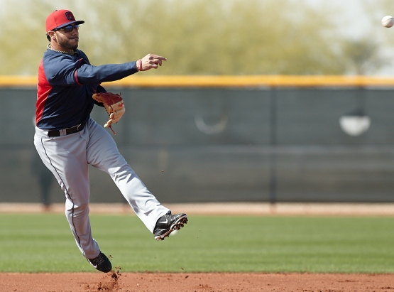 Mike Aviles makes a jumping throw to first during infielder drills.