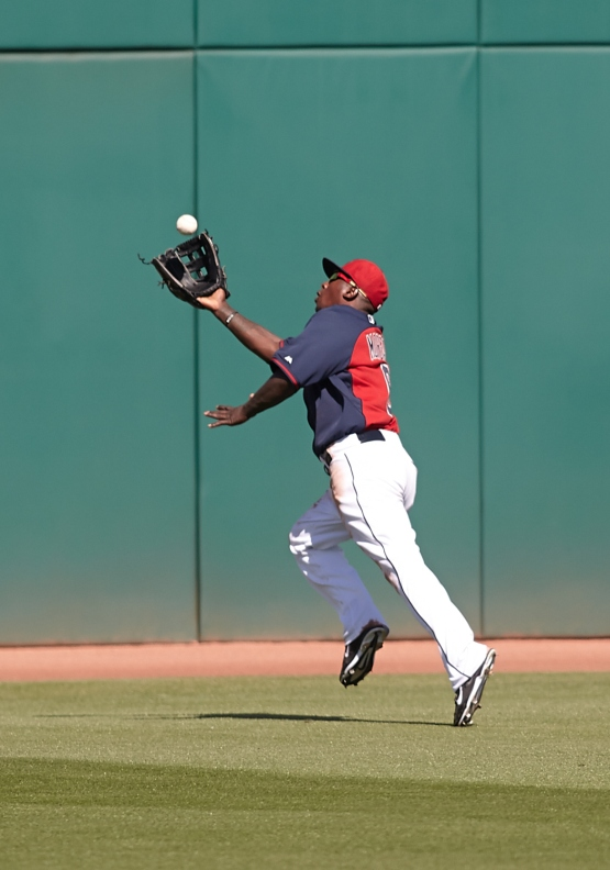 Nyjer Morgan makes an over the shoulder catch in center field.