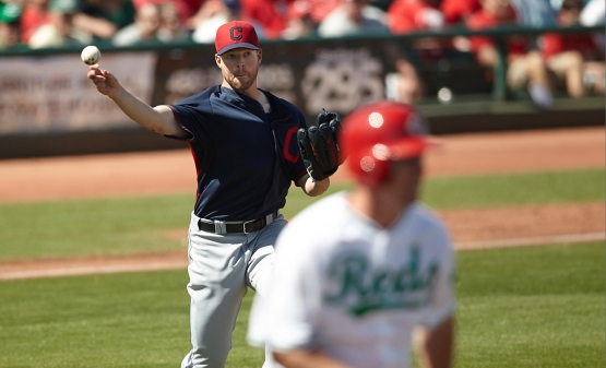 Corey Kluber throws out Reds right fielder Jay Bruce