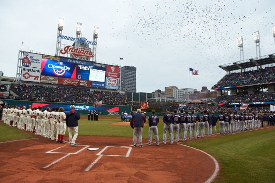 Both teams are lined up for the pre game ceremonies.