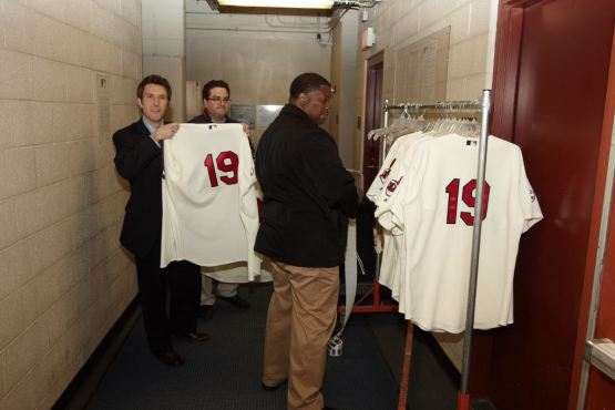 Authenticators verify the uniforms worn by the Indians on Opening Day in 2011; each player wore 19 that day to honor the late Bob Feller.