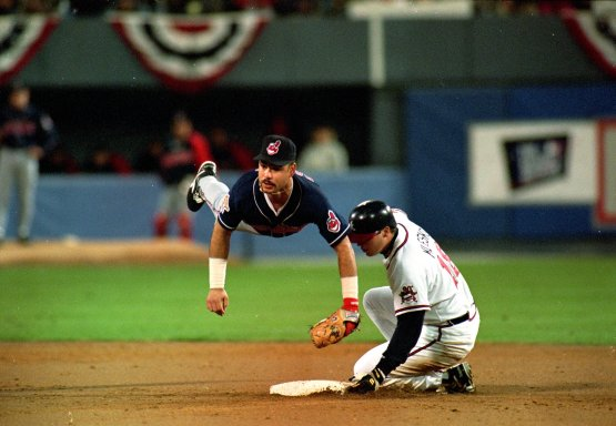 28 Oct 1995: Carlos Baerga #9 of the Cleveland Indians jumps to make a double play as Ryan Klesko of the Atlanda Braves slides into the plate during  game six of the World Series at the Fulton County Stadium in Atlanta, Georgia. The Braves defeated the Indians 1-0. Mandatory Credit: Otto Greule Jr.  /Allsport