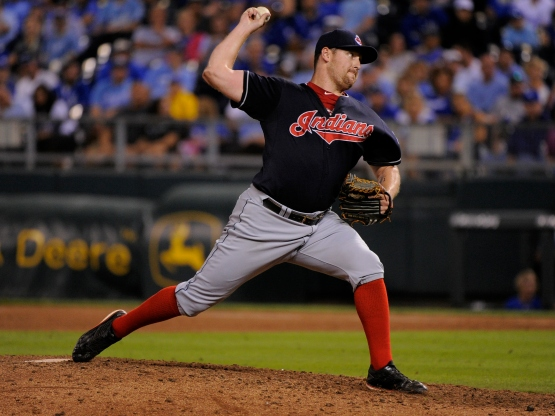 KANSAS CITY, MO - SEPTEMBER 26:  Bryan Shaw #27 of the Cleveland Indians throws in the ninth inning against the Kansas City Royals at Kauffman Stadium on September 26, 2015 in Kansas City, Missouri. (Photo by Ed Zurga/Getty Images)
