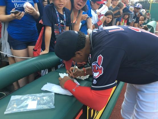 frankie signing batting gloves