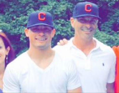 Mitch (left) and Mark (right) Longo donning their Cleveland Indians cap after Mitch made it official. From Twitter: @MitchLongo10